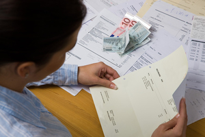 A woman with unpaid bills